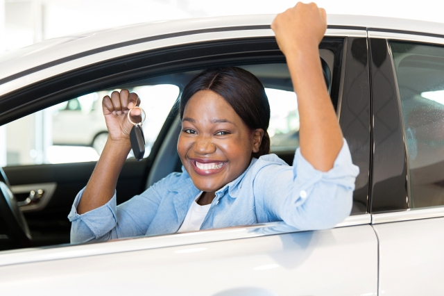young african woman showing her new car key